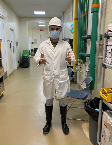 Cofounder Devon Hawkins dressed in full PPE before entering the food production facility in Leduc Alberta Canada
