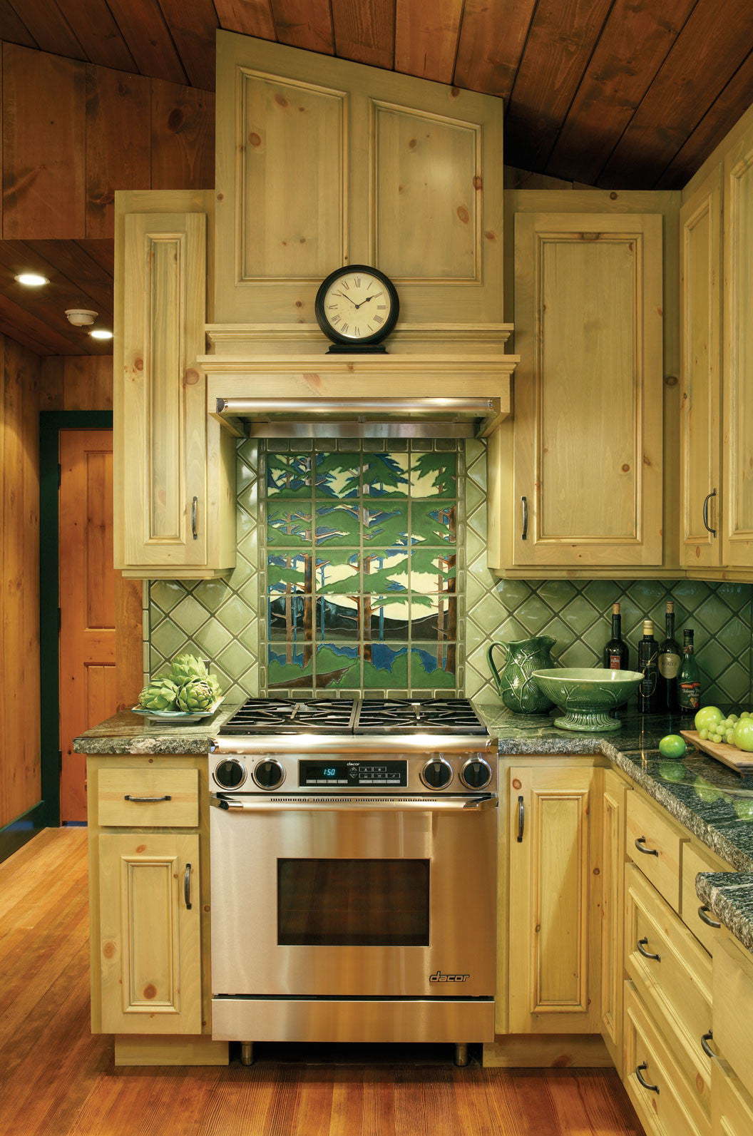 Spotlight on pine landscape motawi tileworks motawis glossy celadon glaze adds a bright tone to this interpretation of our pine landscape mural featured above the stove doublecrazyfo Image collections