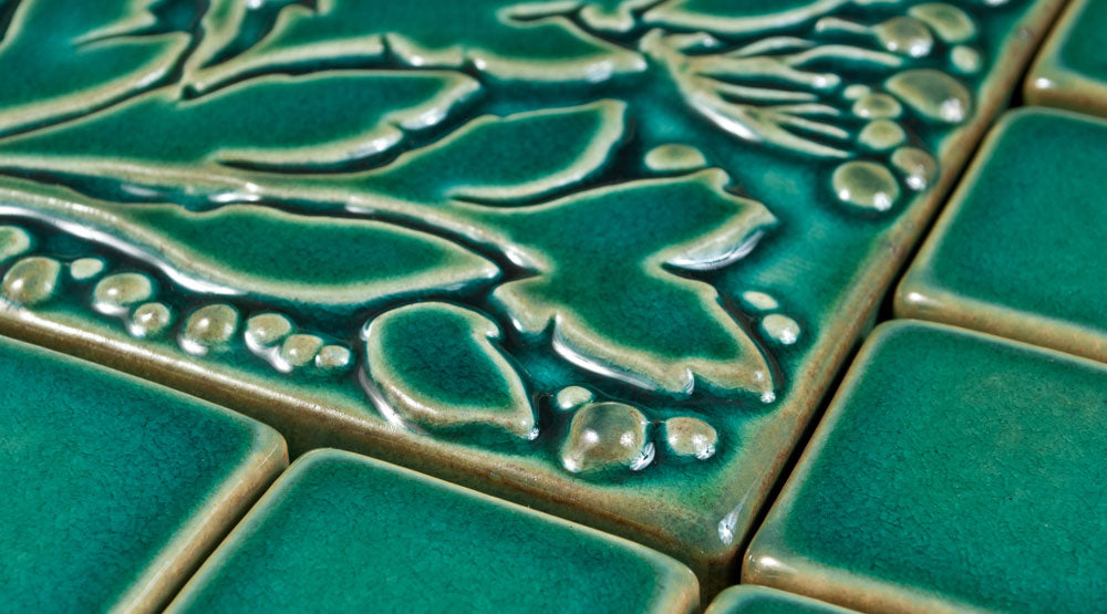Image of turquoise glaze with relief and field tile