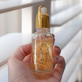 24K Nanogold Face Serum With Hand Holding Bottle