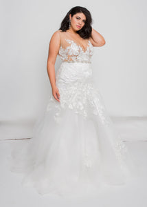Gorgeous bridal gowns for all body shapes: plus size, curvy, or petite brides. Try on our wedding dresses at home. Size 0-30. Comfortable. Convenient. Fun. Lace or satin. Mermaid or A-line. The lace v-neck top meets an ivory skirt that has complementary tulle and lace featured together, giving some unexpected, but welcome twists. The beautiful ivory lace pattern of this skirt draws down into a dramatic, romantic tulle trumpet that will figure-flatter and add interest.