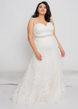 Load image into Gallery viewer, Gorgeous bridal gowns for all body shapes: plus size, curvy, or petite brides. Try on our wedding dresses at home. Size 0-30. Comfortable. Convenient. Fun. Lace or satin. Mermaid or A-line.  The Eva Gown seamlessly blends a luxurious lace pattern with a classic silhouette that follows all the way down to the exquisitely detailed hem. A sweetheart neckline plays perfectly with lace to create one of our most romantic and elegant tops.