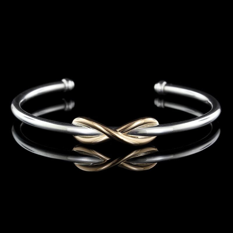 Tiffany & Co. Sterling Silver and 18K Rose Gold Infinity Cuff Bracelet