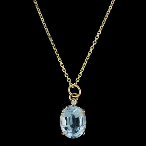 14K Yellow Gold Blue Topaz and Diamond Pendant