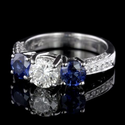 Platinum Diamond and Sapphire Three Stone Engagement Ring