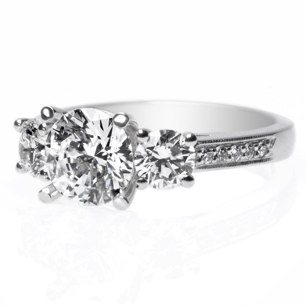 Platinum Three-Stone Channel Set Engagement Ring