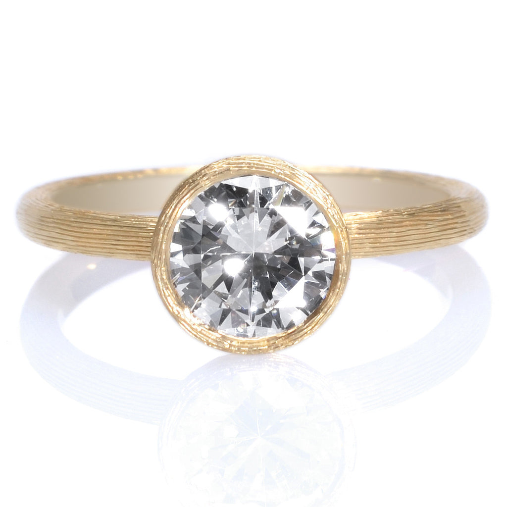 gold in solitaire bezel ring shop engagement diamond style white set swirl