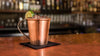Hand hammered copper mug mexican mule on bar