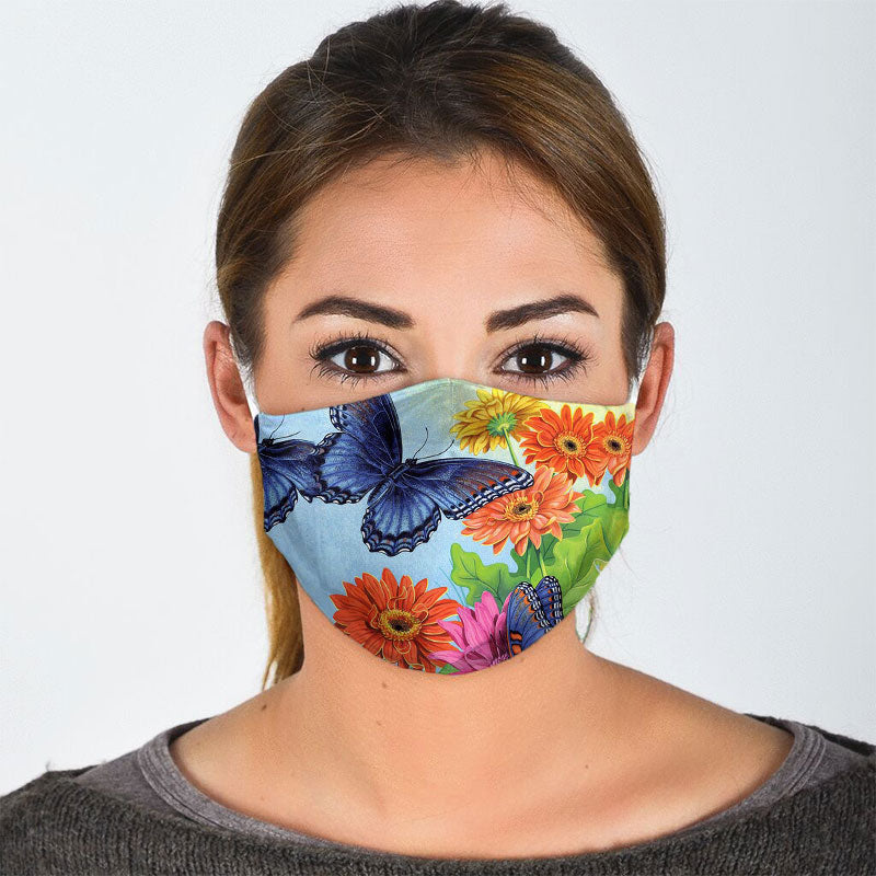 BLUE BUTTERFLY IN THE GARDEN FACE MASK