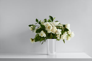 White Vase filled with Gardenias and Peonies