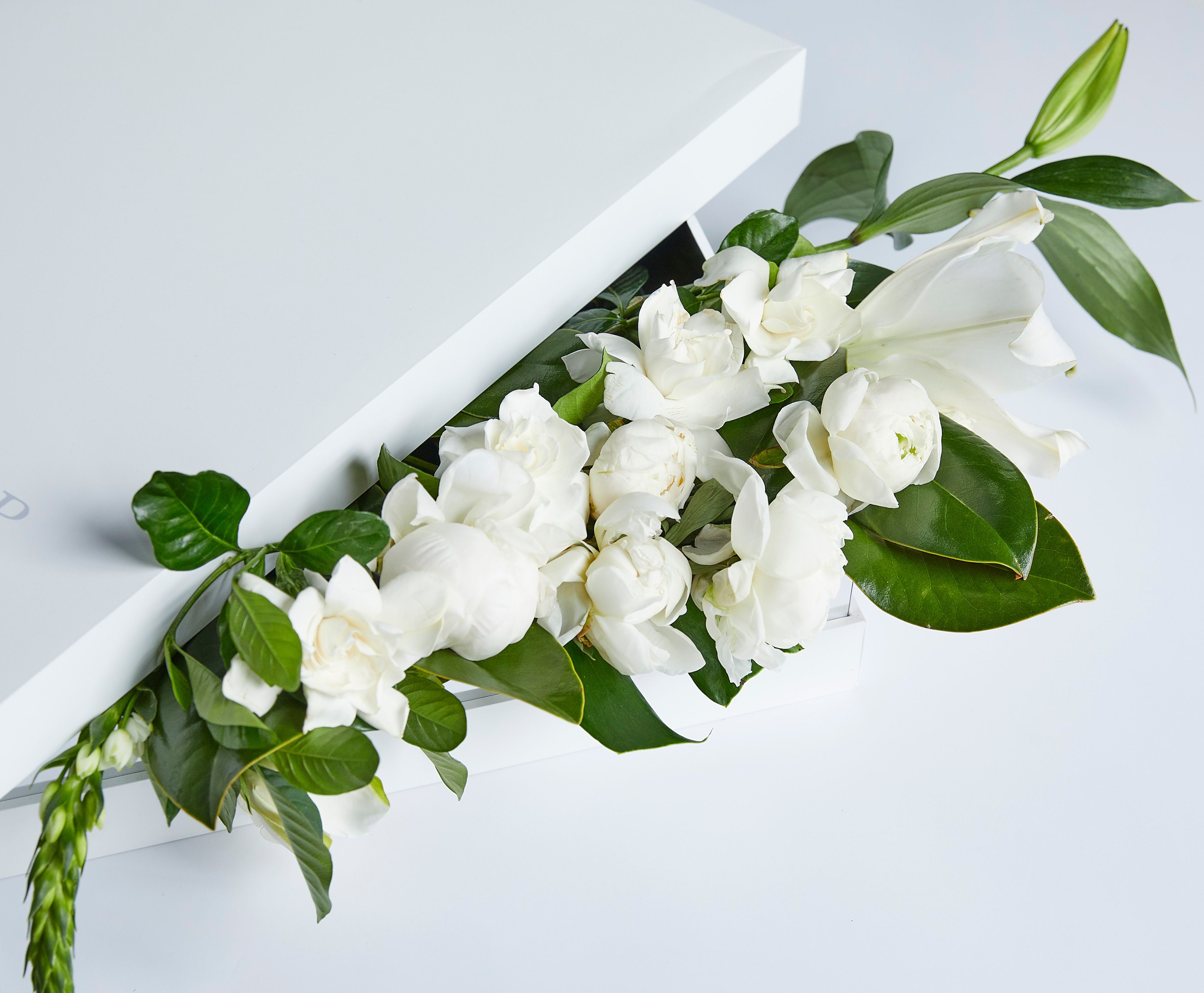 Luxury gift box set with overflowing gardenias and lilies