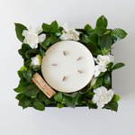 gift box with gardenia flowers leaves palo santo and candle