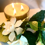 gold candle with wide wood wicks and gardenia gift box