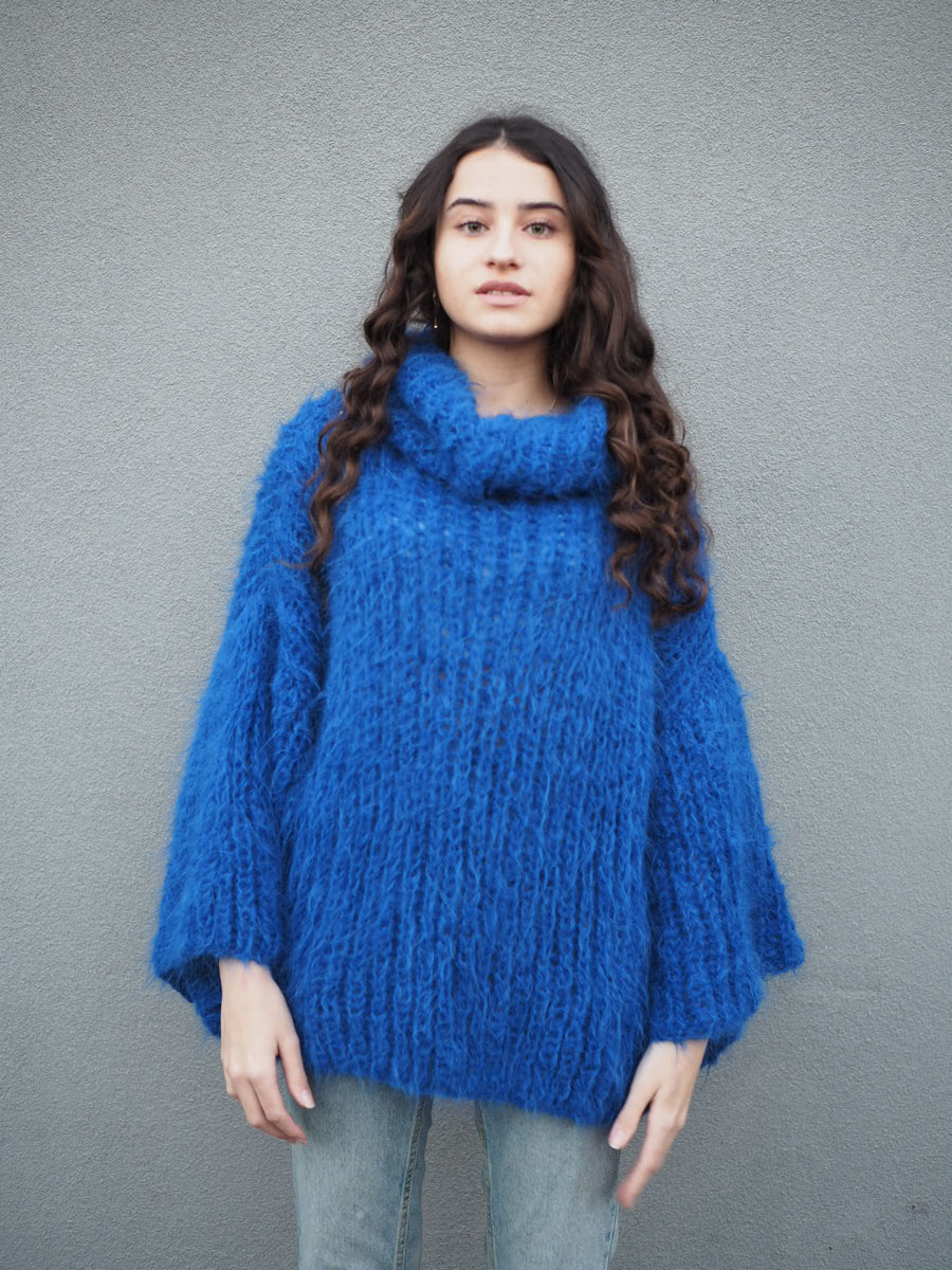 Chunky hand knit sweater with funnel collar