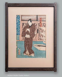 Man in Brown Kimono Standing in a Room