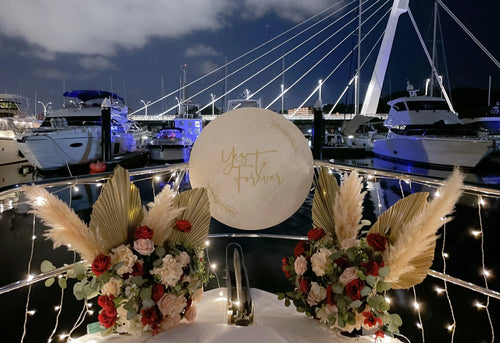 Romantic Yacht Proposal Decor in Singapore with Fairylight Backdrop, Pastel Balloons and Flowers by Style It Simply