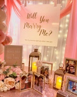 Romantic Hotel Room Proposal in Singapore with Fairy-lights Backdrop & Pink Balloon Garland by Style It Simply