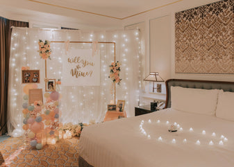 Romantic Hotel Room Proposal in Singapore with Fairylight Backdrop, Pastel Balloons and Flowers by Style It Simply