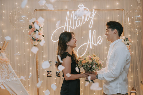 Romantic Hotel Room Proposal Decor in ParkRoyal Collection Marina Bay Singapore with Fairylight Backdrop, Pastel Balloons and Flowers by Style It Simply
