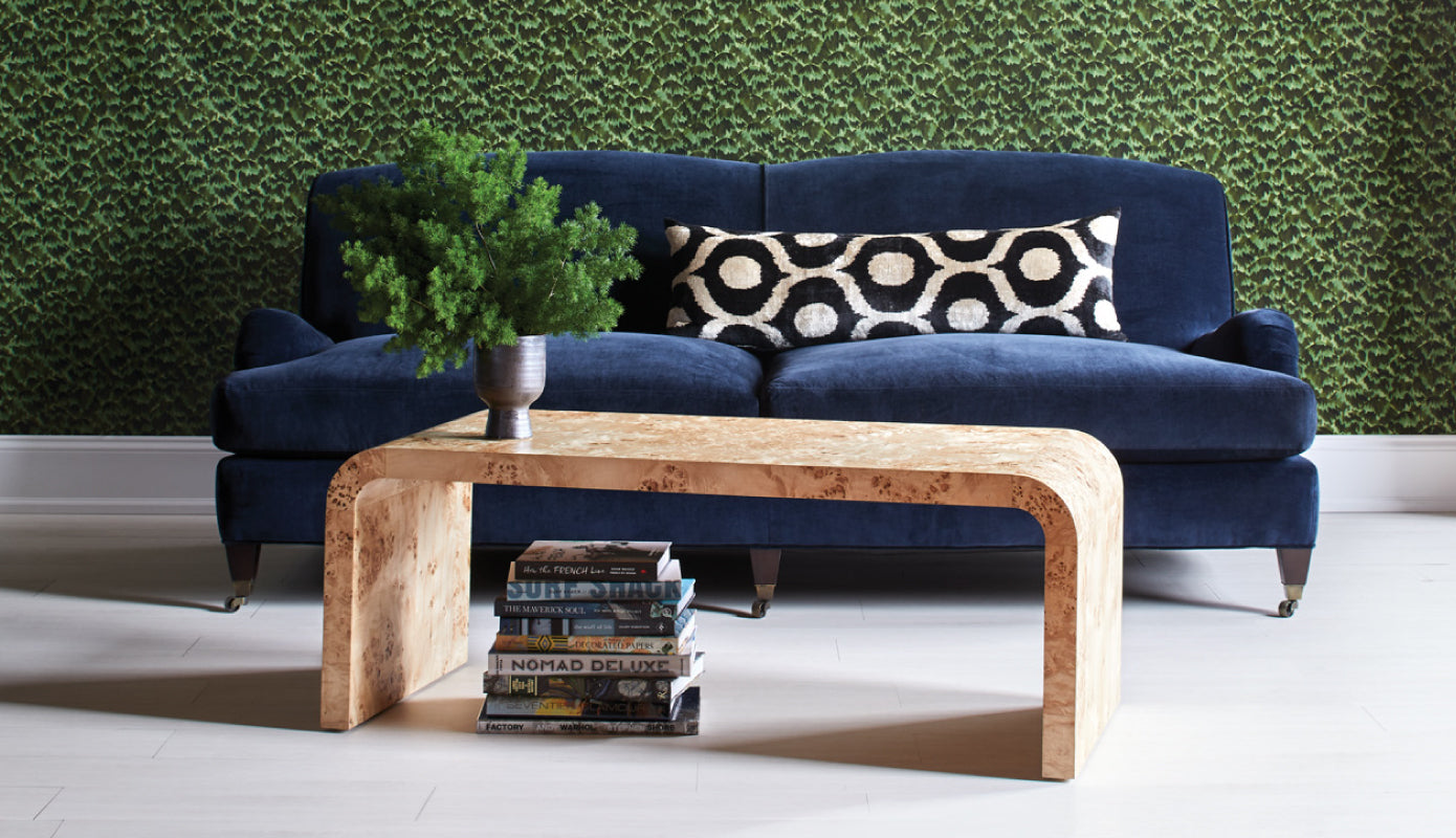 Blue Velvet Dries Sofa, Powell Coffee Table, and various other home accessories
