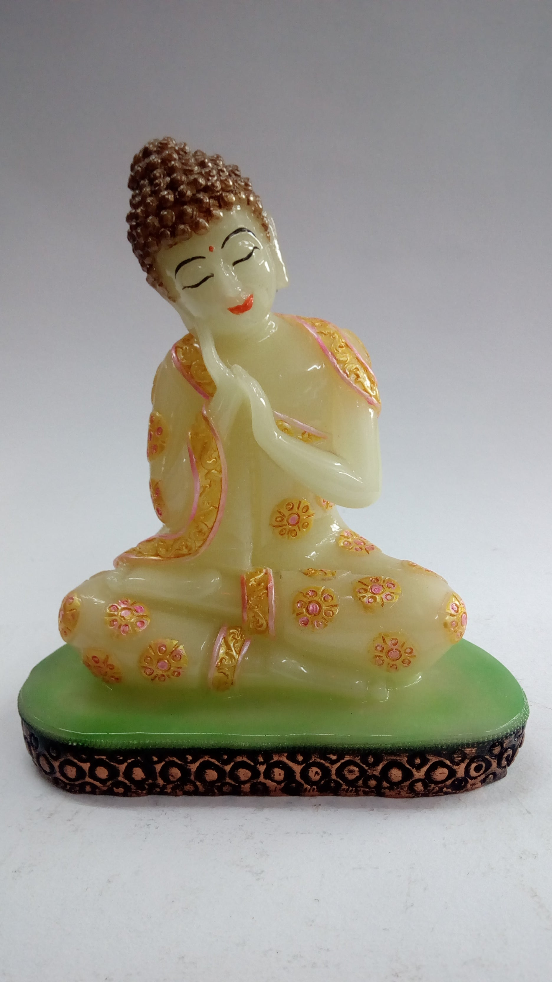 Buy Buddha Sitting showpiece with flower symbols on it AG0147Online