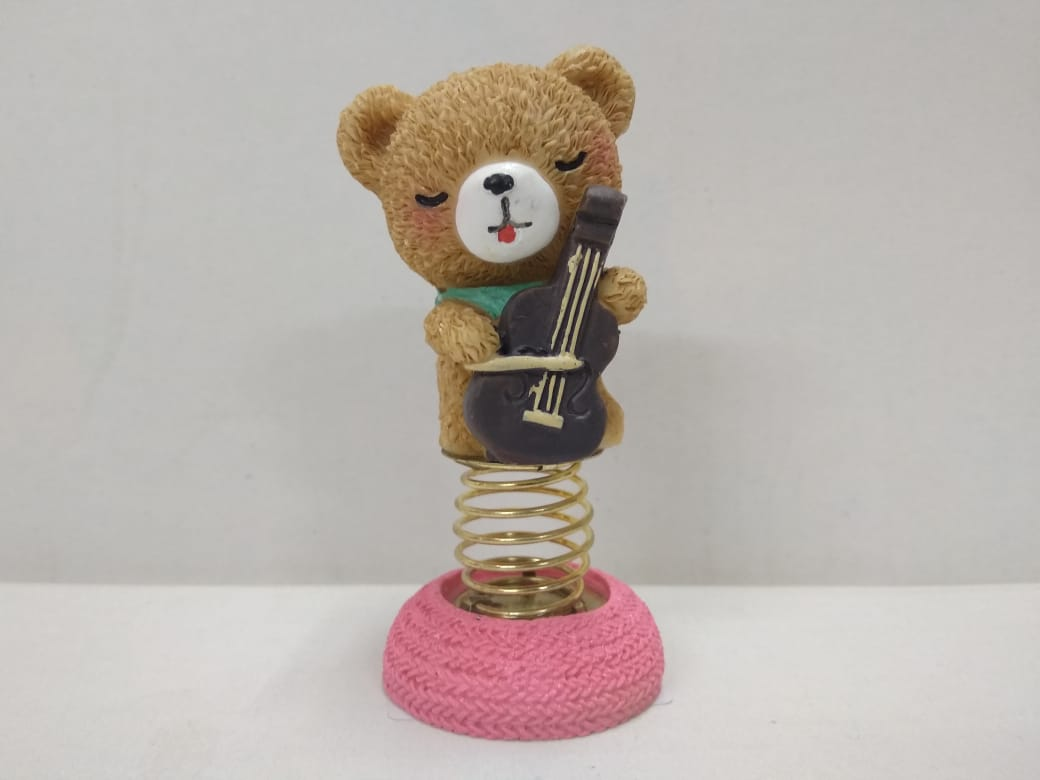 Cute Teddy playing violin with a moving spring...NY164