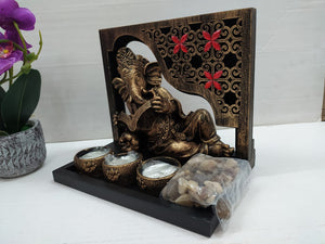 Beautifully stone crafted Book reading Ganesha showpiece with candle holders NY248