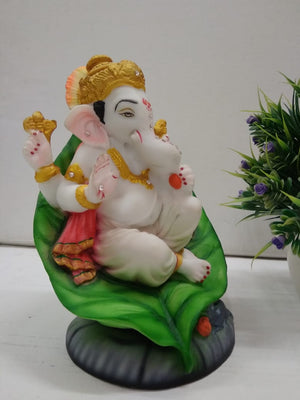 Cute lord ganesh on leaf showpiece   F020