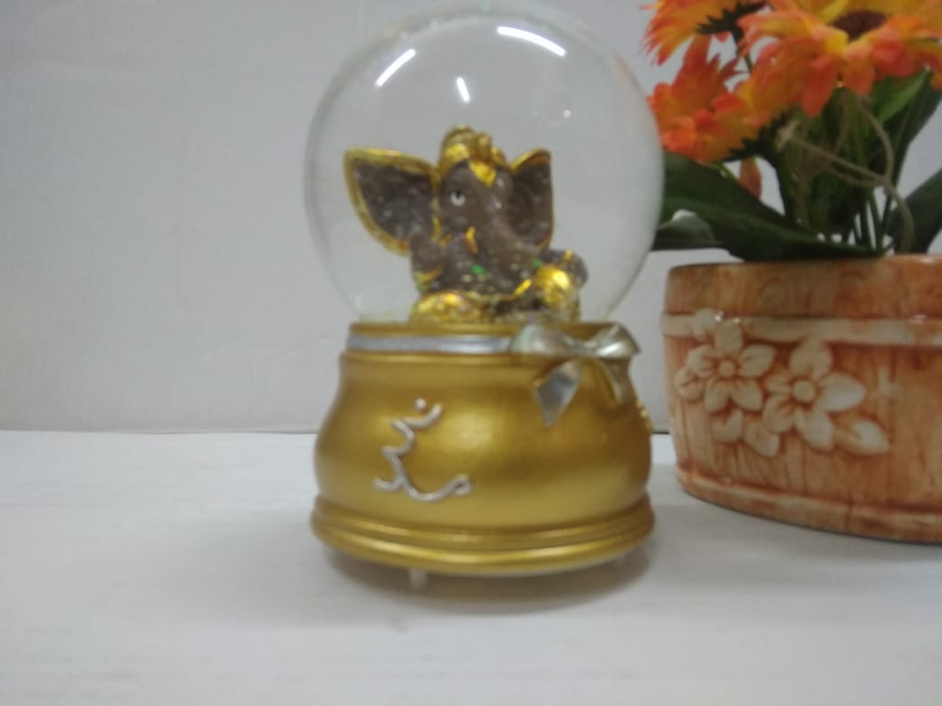 Buy Ganesha in glass ball showpiece with multicolor LED lighting and music SCS24  Online