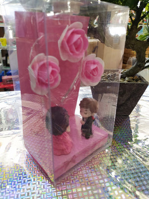 Mini Valentine couple with flower