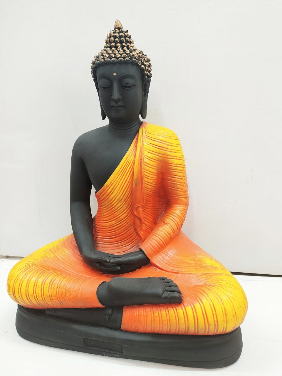 Buy Meditating Buddha in Orange colour AK62 Online