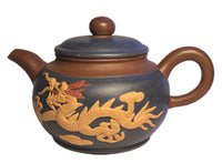 Dragon and Phoenix Yixing tea pot closeup