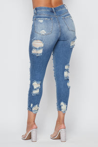 High Waisted Allover Distressed Skinny Jeans in Medium Wash