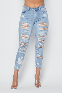 High Waisted Allover Distressed Skinny Jeans in Light Wash