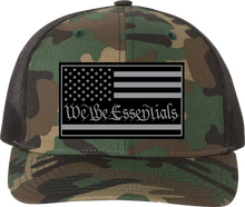 "Load image into Gallery viewer, NEW ""We The Essentials"" Camo and Black Trucker Hat with Grey Patch"