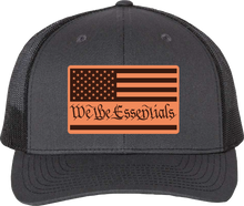"Load image into Gallery viewer, NEW ""We The Essentials"" Grey and Black Trucker Hat with Leather Patch"