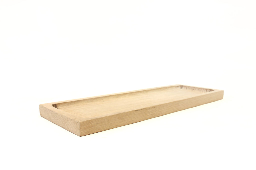 A serving board handmade in our Los Angeles workshop from 100% reclaimed wood.