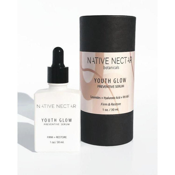 bottle of native nectar botanicals youth glow preventive serum next to packaging container