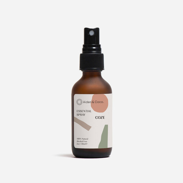 bottle of aiden & coco coze essential spray front