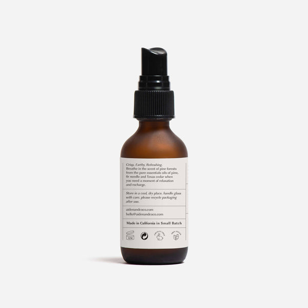 bottle of aiden & coco forest essential spray back