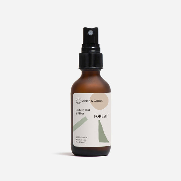 bottle of aiden & coco forest essential spray front