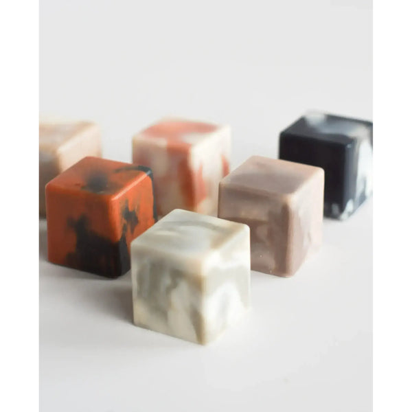 five blocks of clay soap on white surface
