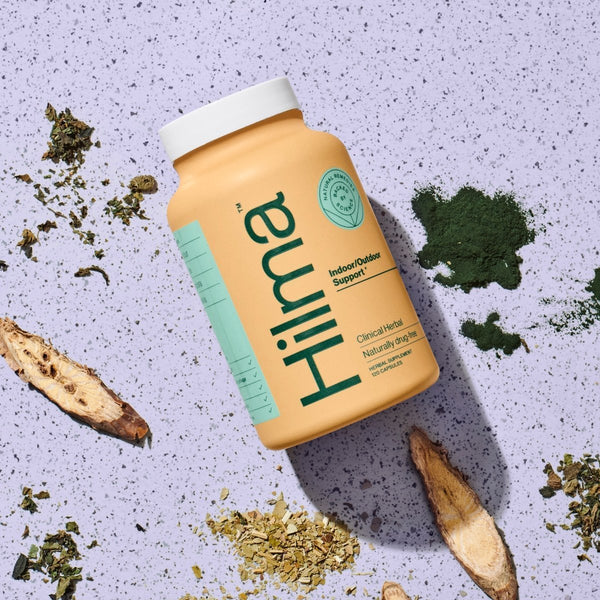 bottle of hilma indoor outdoor support herbal supplement surrounded by ingredients