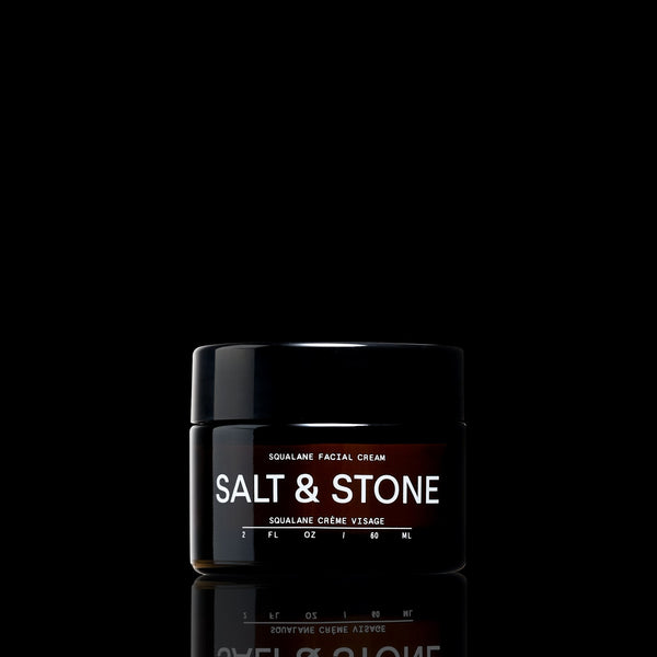 black background with a photo of sqaulane facial cream by salt and stone