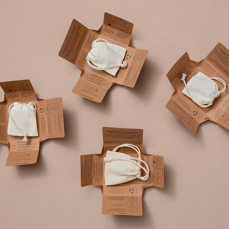 four unboxed organicup size b in white bags