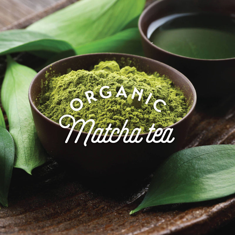 bowl of organic matcha tea surrounded by leaves