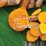 bunch of organic turmeric next to spoon of organic turmeric powder
