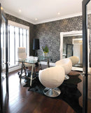 Solid black cowhide rug office interior