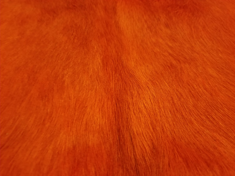 Orange dyed cowhide rug close up