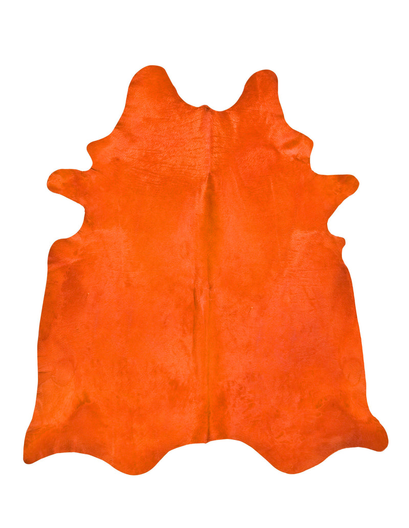 Orange dyed cowhide rug